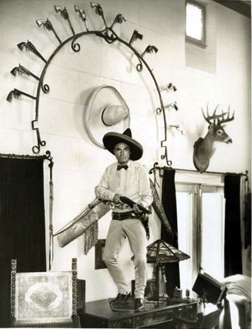 Tom Mix inside his Beverly Hills mansion. The horseshoe shaped arch above him is now in the Dewey, OK, Tom Mix Museum. (Thanx to Bud Norris.)