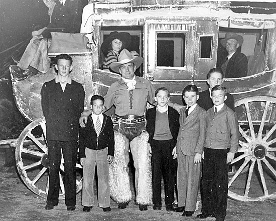 Buck Jones and some boys from the McKinley Home for Boys in Sherman Oaks, CA perpare for a Christmas Parade. The McKinley Home operated from 1920-1960.