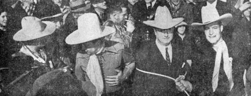 "Charles Starrett (right) tossed a lariat over postmaster general James Farley and topped him off with a cowboy hat. On the left are convention general chairman Pat Flynn and Monte Blue. Actress Rochelle Hudson and Arthur ""Dagwood"" Lake were also in attendance."