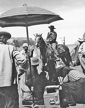 "John Ford (right) directs John Wayne in a scene for ""The Searchers"" in  Monument Valley."