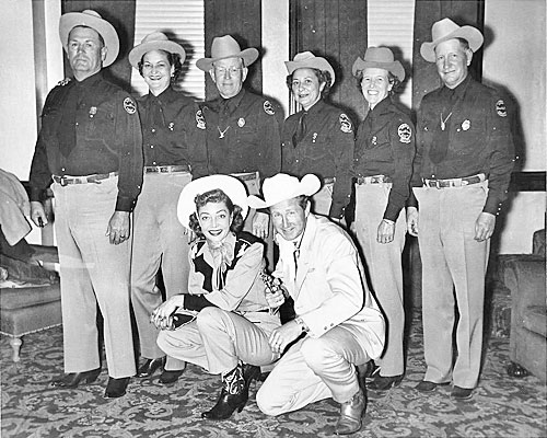 "Marie Windsor, Lloyd Bridges and members of the Truth or Consequences, New Mexico Sheriff's department pose for a photo during the making of ""The Tall Texan"" ('53)."