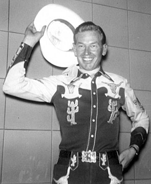 "A young Rex Allen at WLS Radio, Chicago, circa 1945 seems to say, ""See ya next month here on Western Treasures!"""