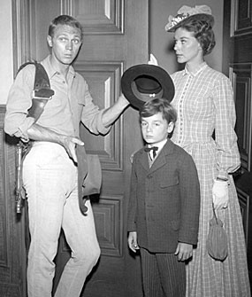 "Steve McQueen, Joyce Meadows and Bryan Russell kid around while on the set of ""Wanted Dead or Alive: One Mother Too Many"" ('60)."