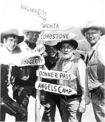 "Which way do we go? The ""Wagon Train"" cast (L-R) Robert Fuller, John McIntire, Michael Burns, Frank McGrath, Terry Wilson. (The hidden sign behind Bob's arm seems to be Modesto.)"