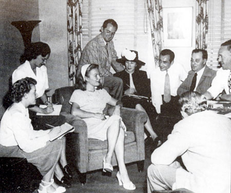 Paramount producer Walter Seltzer (plaid coat) introduces his new find Kristine Miller  to the press in 1946.