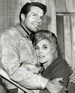 "Robert Horton and Jeanne Cooper take a break from making ""Survival"", an episode of TV's ""A Man Called Shenandoah""."