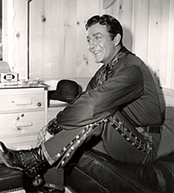 "Robert Taylor relaxes in his dressing room during the making of ""Ride, Vaquero""  ('53 MGM)."