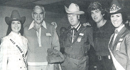 """Bonanza"" stars Lorne Greene (second from left) and Michael Landon (second from right) visit with Miss Rodeo Oklahoma (left) and another Oklahoma Rodeo Queen (right). In the center is Jiggs Beutler, son of Elra Beutler, one of the three well known Beutler Brothers whose livestock was well known across the country in rodeo events. Jiggs was a key player in continuing the Beutler and Son Rodeo Company. (Thanx to John Stovall.)"