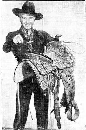 "William Boyd holds the prize saddle that was given to the winner of the Hopalong Cassidy Most Colorful Cowboy or Cowgirl Contest which was held in conjunction with the premiere of ""In Old Mexico"" at the Plaza Theatre in El Paso, Texas in July, 1938. Boyd, Geroge ""Windy"" Hayes and Russell Hayden and his wife-to-be leading lady Jane (Jan) Clayton all made personal appearances for the premiere."