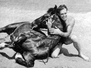 "Ever the sportsman, 6'4"" Jocko and his horse Rebel on the beach at Paradise Cove, Laguna Beach, CA."