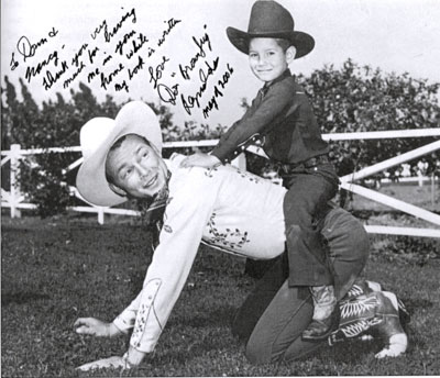 The boy who rode the man who rode the horse. Seven year old Don Kay Reynolds wanted to ride Trigger but he wasn't available that day so the second best thing was to ride Roy. Photo taken at Rogers' home in Encino.