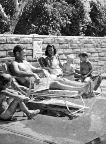 The Connors family relaxes poolside.