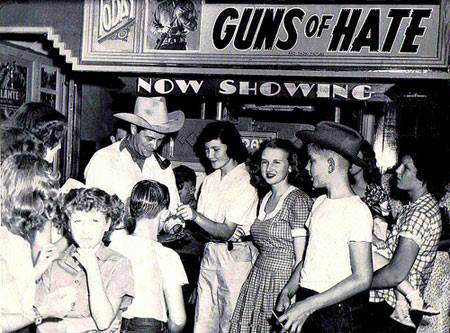 Tim Holt signs a few autographs in August 1948 at the Temple Theatre  in Mangun, Oklahoma.