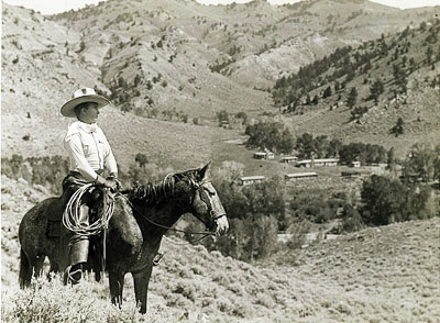 Tim McCoy looks over his Eagle Nest Ranch near Thermopolis, WY. Taken in 1927. (Photo courtesy Elijah Cobb.)