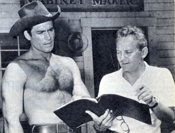 "Clint Walker and director Walter Doniger go over the script for another episode of ""Cheyenne""."