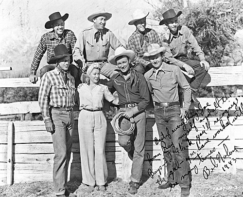 "Candid shot taken during the making of ""Hands Across the Border"" ('44 Republic). Roy Rogers and the Sons of the Pioneers with veteran stuntwoman Nellie Walker. Bob Nolan inscribed the photo to former stuntman and serial star Joe Bonomo who had worked with Nellie years before. (Courtesy Ed Hulse.)"