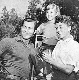 """Cheyenne""—Clint Walker with wife Verna and daughter Valerie."