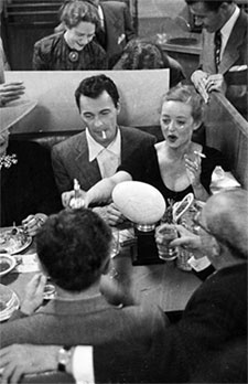 """The Tall Man""—Barry Sullivan dines with Bette Davis."