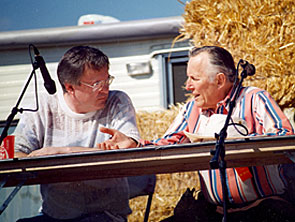 """The Rough Riders""—Jan Merlin chats with moderator Boyd Magers of WESTERN CLIPPINGS during a panel discussion in Apache Junction, AZ in the '90s."