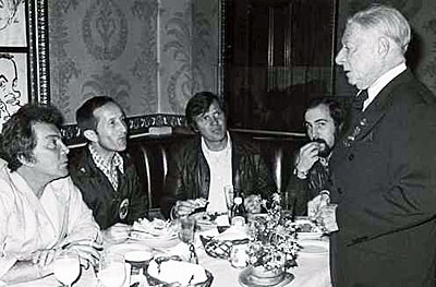 """High Chaparral""—Cameron Mitchell and others listen intently to Toast Master Georgie Jessel at the Brown Derby in 1978."