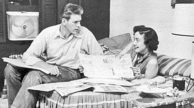"""Pony Express""—Grant Sullivan and wife Mary in their New York apartment looking at house plans in 1955."