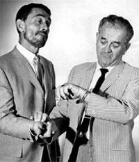 """Gunsmoke""—Milburn ""Doc"" Stone checks the pulse of Ken Curtis  just to be sure."