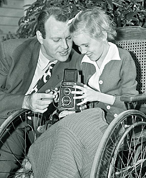 """High Chaparral""—Leif Erickson helps a young fan with her camera."