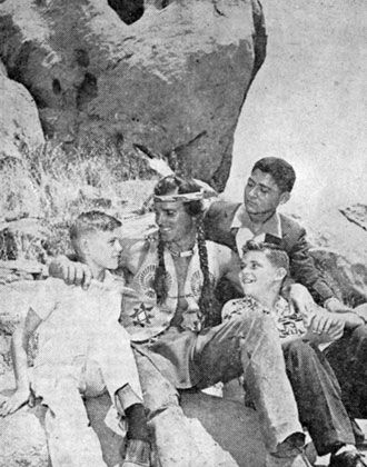 "On the set of ""Brave Eagle"", produced by Roy Rogers, are Jerry Thompson, Joe Howley and Pete de la Santos, newsboy carriers from the SAN ANTONIO NEWS EXPRESS. They were guests of Roy in Hollywood after winning a big circulation contest when Roy appeared in San Antonio with his championship rodeo. Keith Larsen was the star of ""Brave Eagle""."