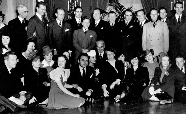 Eleanor Roosevelt's 1941 birthday celebration at the White House. Can you spot Red Skelton, Kay Kyser, Tyrone Power, Mickey Rooney, Pat O'Brien, Gene Autry, Edward Everett Horton, Elsa Lancaster, Ginny Simms, Deanna Durbin, Edward G. Robinson, William Boyd, Eleanor Roosevelt (right of Boyd), Olivia de Havilland, James Cagney. (We understand William Boyd was upset that Gene Autry wore a Western suit instead of a regular dress suit.) Can you spot any celebrities we've missed?