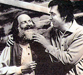 """Daniel Boone"" (Fess Parker) tweeks the beard of rascally sidekick Cincinnatus (Dallas McKennon), tavern-keeper at Fort Boonesborough. D'ja know? Dallas was one of the busiest voice-over artists at Disney Studios...working on ""100 Dalmations"", ""Lady and the Tramp"" and ""Mary Poppins"" among others."