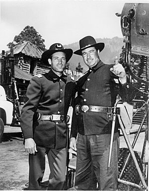 "On location in Mexico City, Guy Madison meets J. Trinidad Villa, son of Pancho Villa, who plays a Civil War soldier in ""The Last Frontier"" with Madison and  Victor Mature. ('55)."
