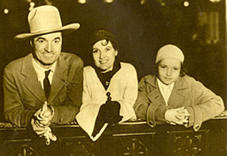 Tom Mix and new wife Mabel Ward Hubbell. Ceremony took place February 15, 1932 in Mexicali, Mexico. Beside them is Tomasina, Mix's daughter by his former marriage to Vicky Forde.
