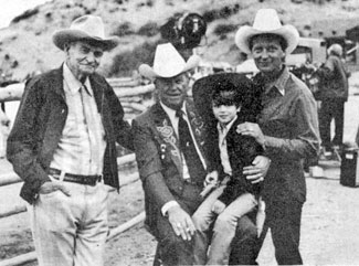 (L-R) Yakima Canutt, Rex Allen, 6 year old Scott Blair and Rex Allen Jr. on location for taping of a Merv Griffin special at Snuff Garrett's ranch in Bell Canyon, California on June 18, 1982. The special aired in July 1982 and also featured Roy Rogers, Gene Autry and Dusty Rogers.