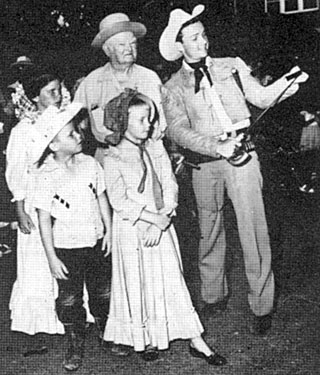 "Celebrating the premiere of ""The Last Command"" ('55 Republic), in Uvalde, TX, Ben Cooper, one of the stars of the film, stopped to call on John Nance Garner, former Vice President of the United States, where some young direct descendents of the heroes of the Alamo were introduced to Nance and Cooper."