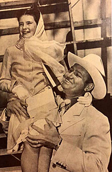 "Gene Autry with young ""rising star"" Margaret O'Brien."