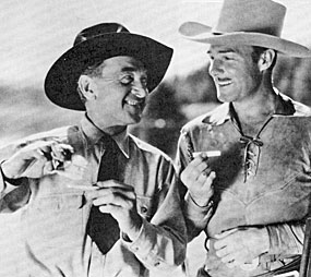 "Harry Carey and Randolph Scott roll their own in between scenes of Paramount's ""Man of the Forest"" ('33)."