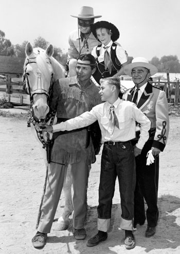 Some young fans join The Lone Ranger and Tonto at one of Sheriff Gene Biscaluz' annual rodeoes.