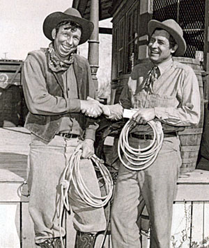 Slim Pickens hands an award to Will Rogers Jr. making him an honorary member of the Rodeo Cowboys Association in 1952.
