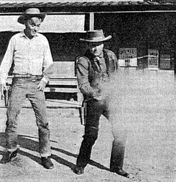 "The fastest gun in Hollywood, Arvo Ojala, shows Will ""Sugarfoot"" Hutchins  how it's done."