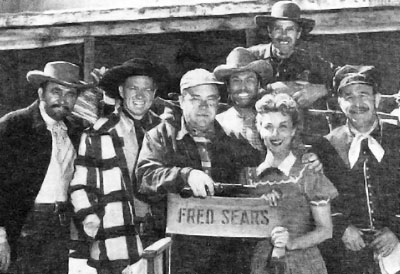 "On the set of ""Apache Ambush"" ('55 Columbia)...director Fred Sears, star Bill Williams to his right, leading lady Adelle August to his left...and is that Clayton Moore between Sears and August? Other three unknown."