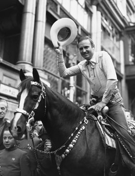 Gene Autry and Champion held a reception for fans outside the Savoy Hotel in London, England on August 2, 1939.