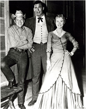 Clint Walker with Michael O'Shea and Virginia Mayo. O'Shea and Mayo were married from '47 til his death in '73.