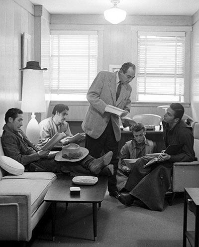 "A ""Rawhide"" cast script read through. (L-R) Sheb Wooley, unknown, unknown (probably the director), Clint Eastwood, Eric Fleming."
