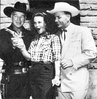 Barbara Britton and Jimmy Wakely at a birthday party for  William Boyd...Hopalong Cassidy.