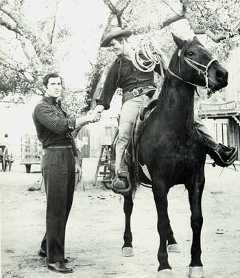 "Dressed in his civvies, Clint (""Cheyenne"") Walker shakes hands with Ty Hardin in costume for his ""Bronco"" series on the Warner Bros. back lot in 1958. (Thanx to Neil Summers.)"