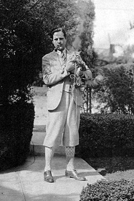 An off-the-range Ed Cobb dressed in his Plus Fours (golf pants) with pipe in mouth. Looks as if he's been walking his cat...how else to explain the leash? Obviously taken in the '30s. (Thanx to John Bickler.)