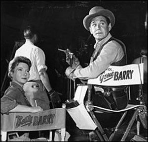 "Gene Barry joins his wife, Betty, on his ""Bat Masterson"" set during her guest appearance in the ""No Amnesty for Death"" episode in '61."