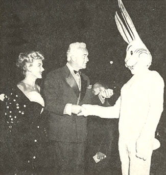 William (Hopalong Cassidy) Boyd, accompanied by his wife, Grace Bradley, presents his card to Harvey, the unseen giant rabbit of the James Stewart starrer of the same name in 1950.