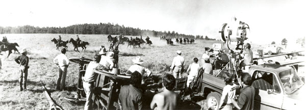 "MGM TV's production crew on location in Canon City, Colorado, for ""How the West Was Won"" that starred James Arness. Above photo shows troopers maneuvering for attack during an Indian war. The Westernaires, a unit of 60 young men, were retained by executive producer John Mantley to serve as U.S. Cavalry troopers."