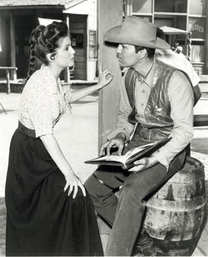 "Karen Sharpe and Don Durant talk over the script for another episode of CBS' ""Johnny Ringo""."